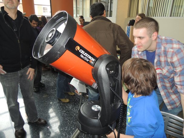 My son, Carrington with a telescope at Rutgers
